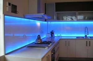 back-lit painted glass blue backsplash