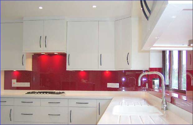 back-lit painted glass red backsplash