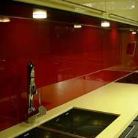 deep red back-painted glass in kitchen