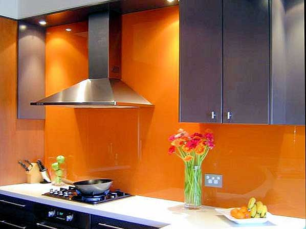 back-lit painted glass orange backsplash