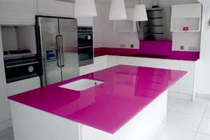 back-painted glass pink backsplash and countertop