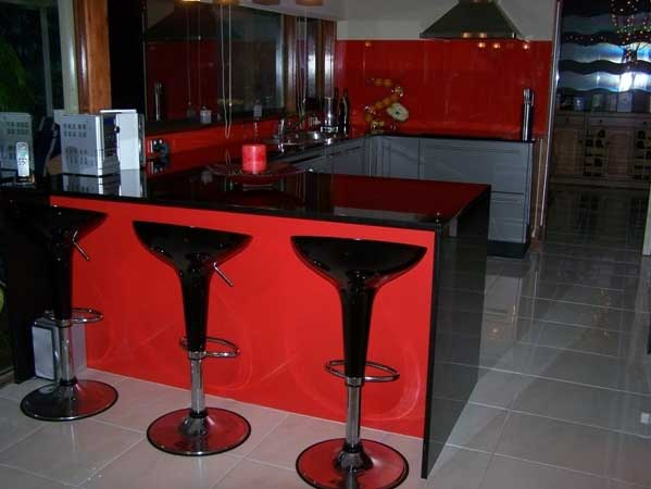 back-lit painted glass red backsplash and kickspace
